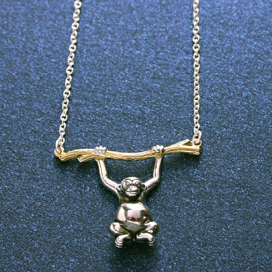 Silver Monkey Necklace With Gold Plated Branch