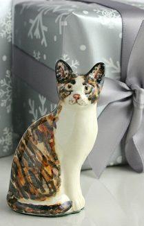 TORTOISESHELL SITTING CAT