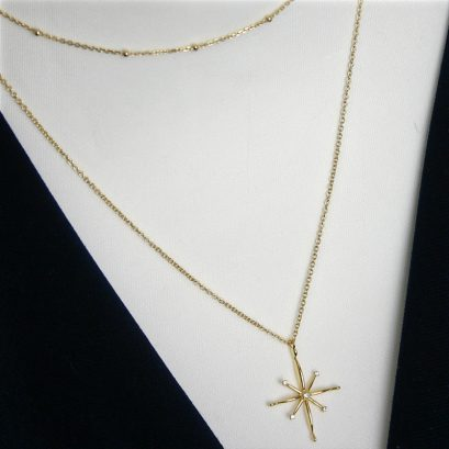 Double Gold Plated Necklace Featuring A North Star Motif
